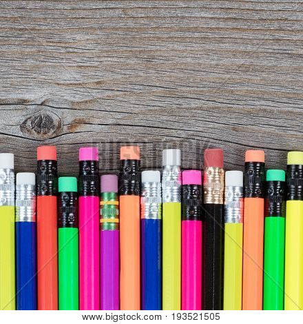 Colorful pencils on rustic wood for Back to School concept