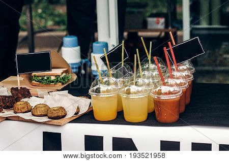 Colorful Lemonades With Empty Cards On Table, Space For Text. Street Food Festival. Drink Bar At Rec