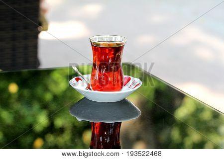 Turkish tea with traditional teaglass close up image