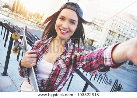Happy Moments Must Be Saved. Cheerful, Young And Beautiful Hipster Woman In Shirt And Cap Holding Ca