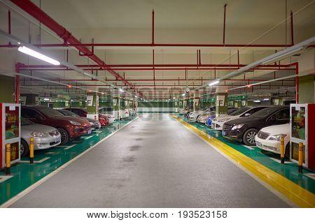 SHENZHEN, CHINA - DECEMBER 16, 2014: underground parking in ShenZhen. ShenZhen is regarded as one of the most successful Special Economic Zones.