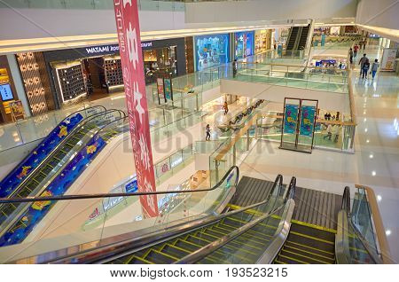 SHENZHEN, CHINA - DECEMBER 16, 2014: inside a shopping center in ShenZhen. ShenZhen is regarded as one of the most successful Special Economic Zones.