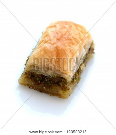 Turkish baklava with pistachio on white background