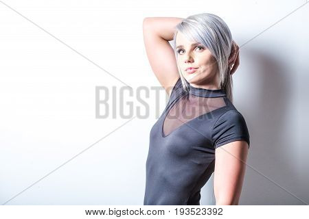 Sexy Female Fitness Model In A Studio With Dramatic Lighting And Sexy Outfit