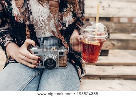 Stylish Hipster Woman Holding Old Photo Camera And Lemonade. Boho Girl In Denim And Bohemian Clothes