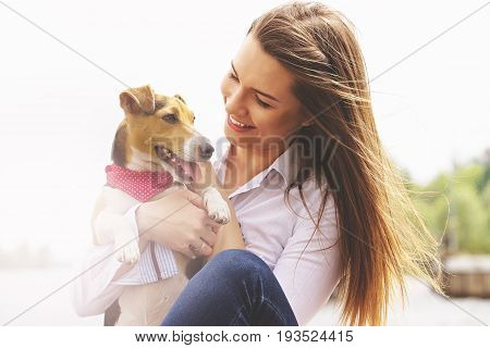 Me And My Lovely Pet. Portrait Of Young Attractive Woman In Casual Wear Looking At Dog And Smiling W