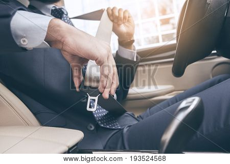 Young business person test drive new vehicle fasten seat belt
