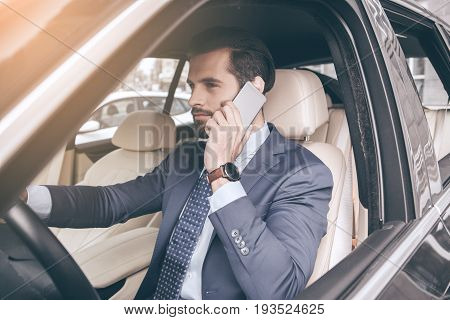 Young business person test drive new vehicle using digital device