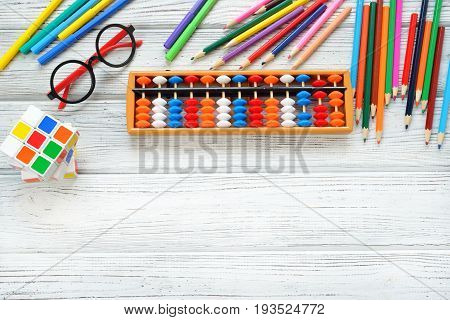 Colorful back to school supplies top border over white table. Mental arithmetic. Space for text. Flat lay style