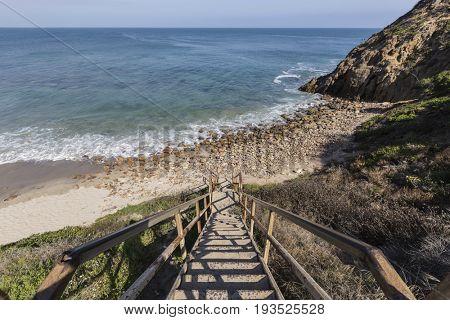 Public beach stairs at Dume Cove in Malibu, California.