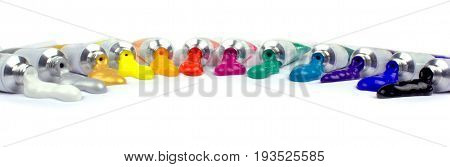 Paint tubes banner on white background close up image