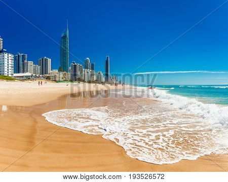 SURFERS PARADISE, AUS - SEPT 05 2016 Skyline and a beach of Surfers Paradise, Gold Coast. It one of Australia's iconic coastal tourist destinations.