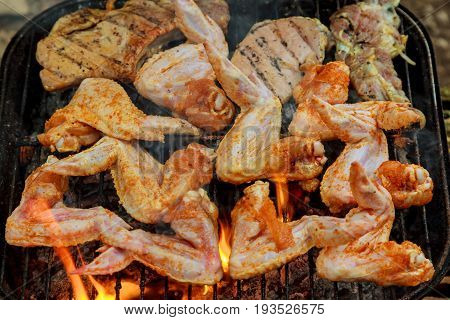 Chicken Wings On Barbecue Grill With Fire