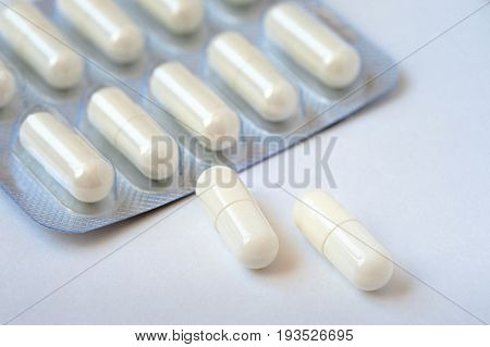 Used pills pack on white table. medicine pill in pack of medicine pills and capsules