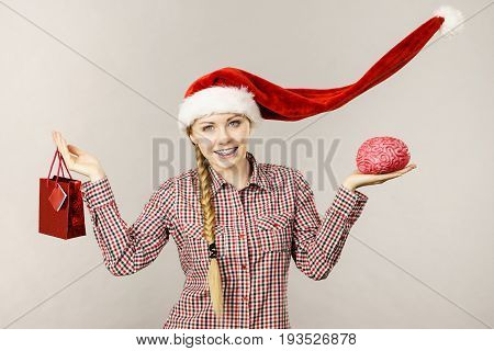 Christmas Woman Holding Shopping Bag And Brain