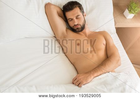 Young male traveler tourist hotel accomodation sleeping