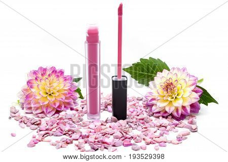 Lip gloss pink on a white background with flowers