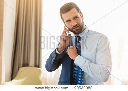 Young male business traveler hotel accomodation phone call