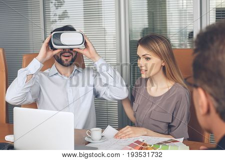 Young couple consultation with agent purchase rent property real estate using digital device