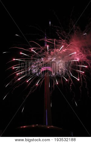 Colorful fireworks from tower on the background of dark sky