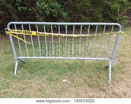 metal bike rack with yellow police line do not cross tape on it