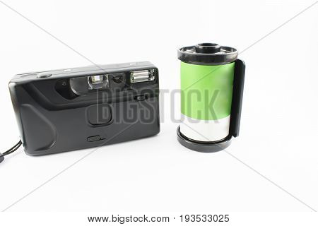 Old photo camera with a green roll on a white background.