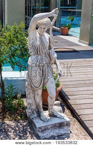 Greek archaic statue located at Corfu island in Greece