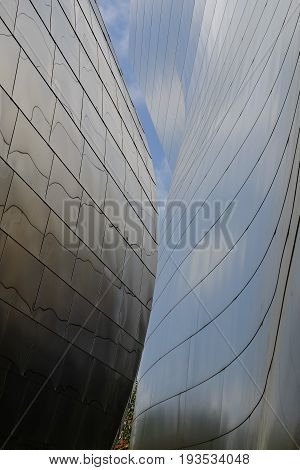 Silver metallic building abstract sections with sky.