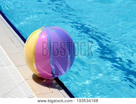 Beachball and swimmingpool close up image .