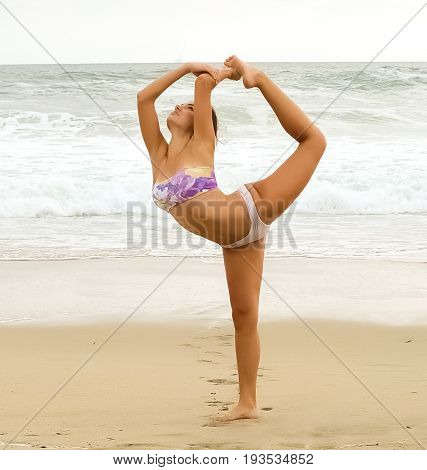 Young girl playing and doing yoga at the beach.
