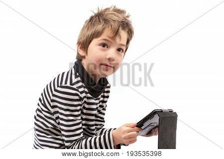 Geek young boy holding a tablet in a bad posture can make him unhealthy