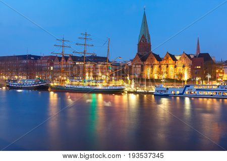 Night view of the Weser River and Protestant Lutheran Saint Martin Church in the old town of Bremen, Germany.