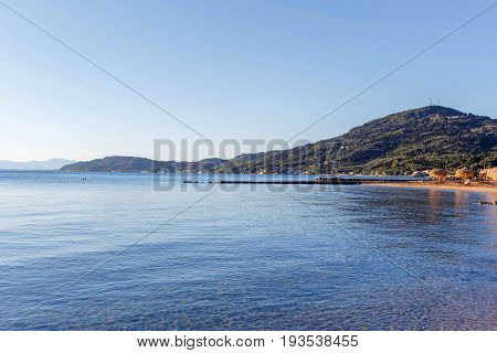 Beautiful view on mountains and seacoast at sunset in Greece, Corfu