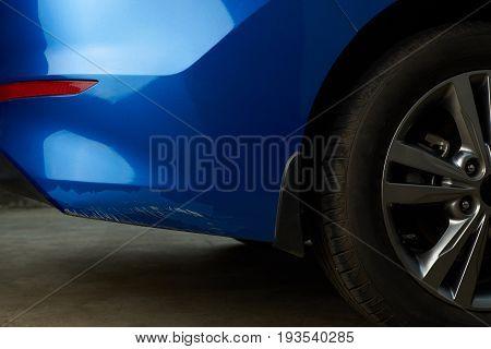 New car with damage paint on bumper. Big car paint scratch