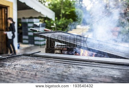 Grill heating up ready to start cooking. Outdoors restaurant