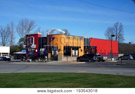 BAY VIEW, MICHIGAN / UNITED STATES - NOVEMBER 26, 2016: One may eat fried chicken at KFC, and tacos at the Taco Bell restaurant.