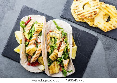 Mexican Chicken Tacos With Grilled Pineapple On Slate Board