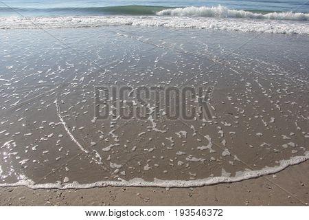 Ocean waves hit the beach on the East Coast.