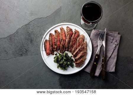 Medium Rare Beef Steak On White Plate, Glass Of Red Wine