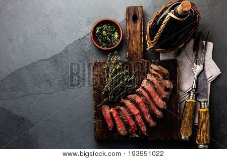 Slices Medium Rare Beef Steak With Herb Sauce, Bottle Of Wine, Copy Cpace