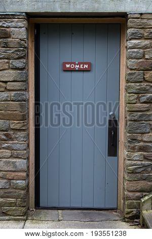 Rustic Womens Room Door to rest area services