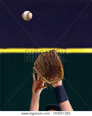 Outfielder hand trying to catch baseball ball