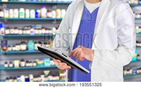 Pharmaceutical staff at drugstore with medicine in background