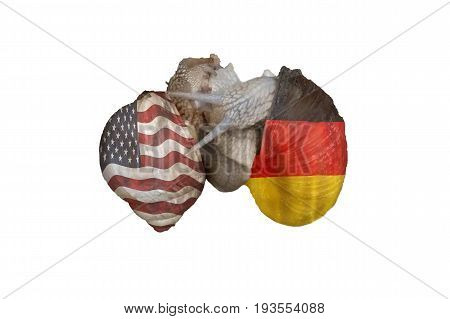 Two vine snails at Lovemaking. On the snail shells once the flag of America and on the other the German national flag. Concept German American Friendship.