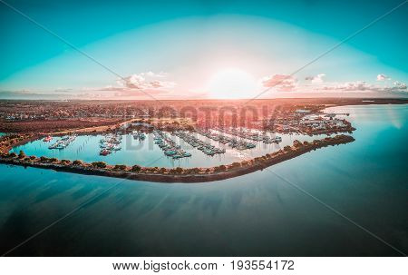 Boats moored at beautiful marina at sunset aerial view. Hastings Victoria Australia