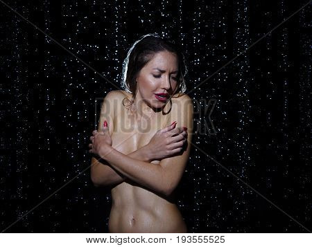 Cold Young Woman Shivering In A Shower