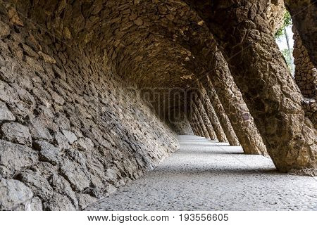Tunnel passage with pillars from south at park Güell in Barcelona