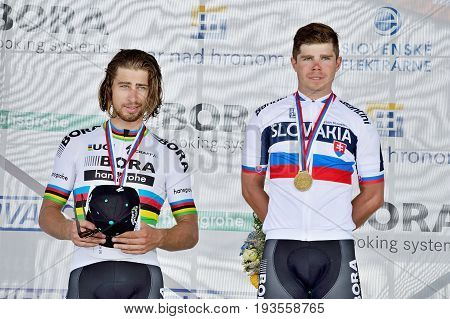ZIAR NAD HRONOM, SLOVAKIA - JUNE 26, 2017: The Slovak and Czech National road cycling championship. Medail ceremony. Sagan brothers from Bora Hansgrohe cycling team with gold and silver medail. Free public meeting