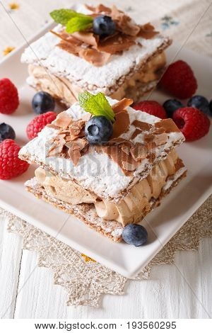 Millefeuille With Coffee Cream, Decorated With Berries And Mint Close-up. Vertical