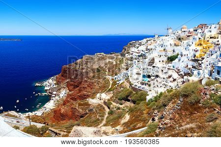 Skyline of Oia, traditional white architecture with windmills, greek village of Santorini, Greece. Santorini is island in Aegean sea.